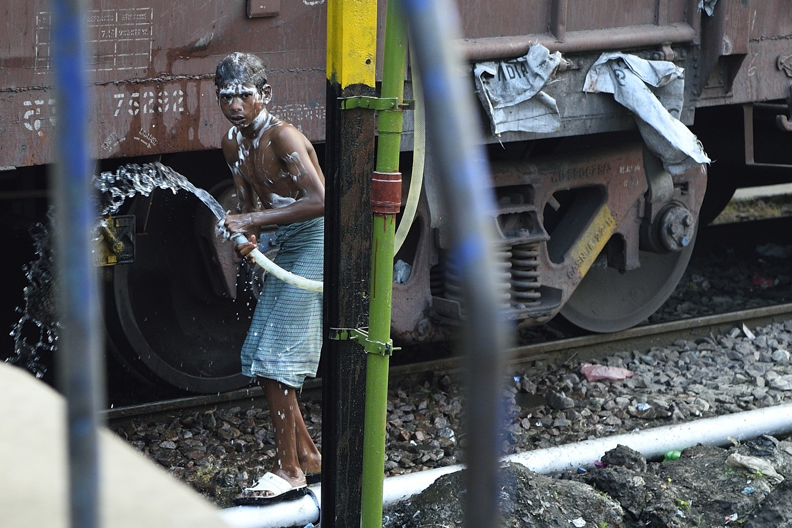 living india: take a shower at the railway station