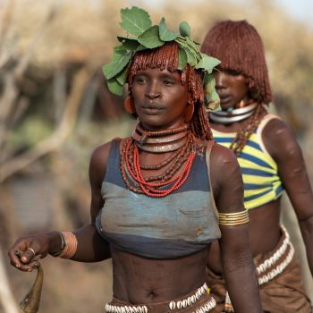 beautiful ethiopian ladies, preparing the bull jump