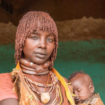kids from ethiopia by albi: the mother with sleeping child